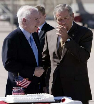 Bush eating cake while Katrina approaches