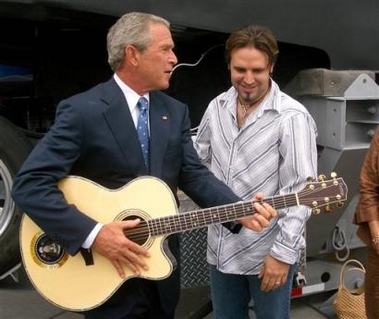 Bush playing guitar while New Orleans floods
